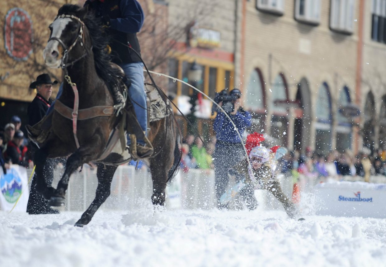 Winter Carnival princess Kaelyn Radway crashed during the donkey jump competition during street events Saturday.