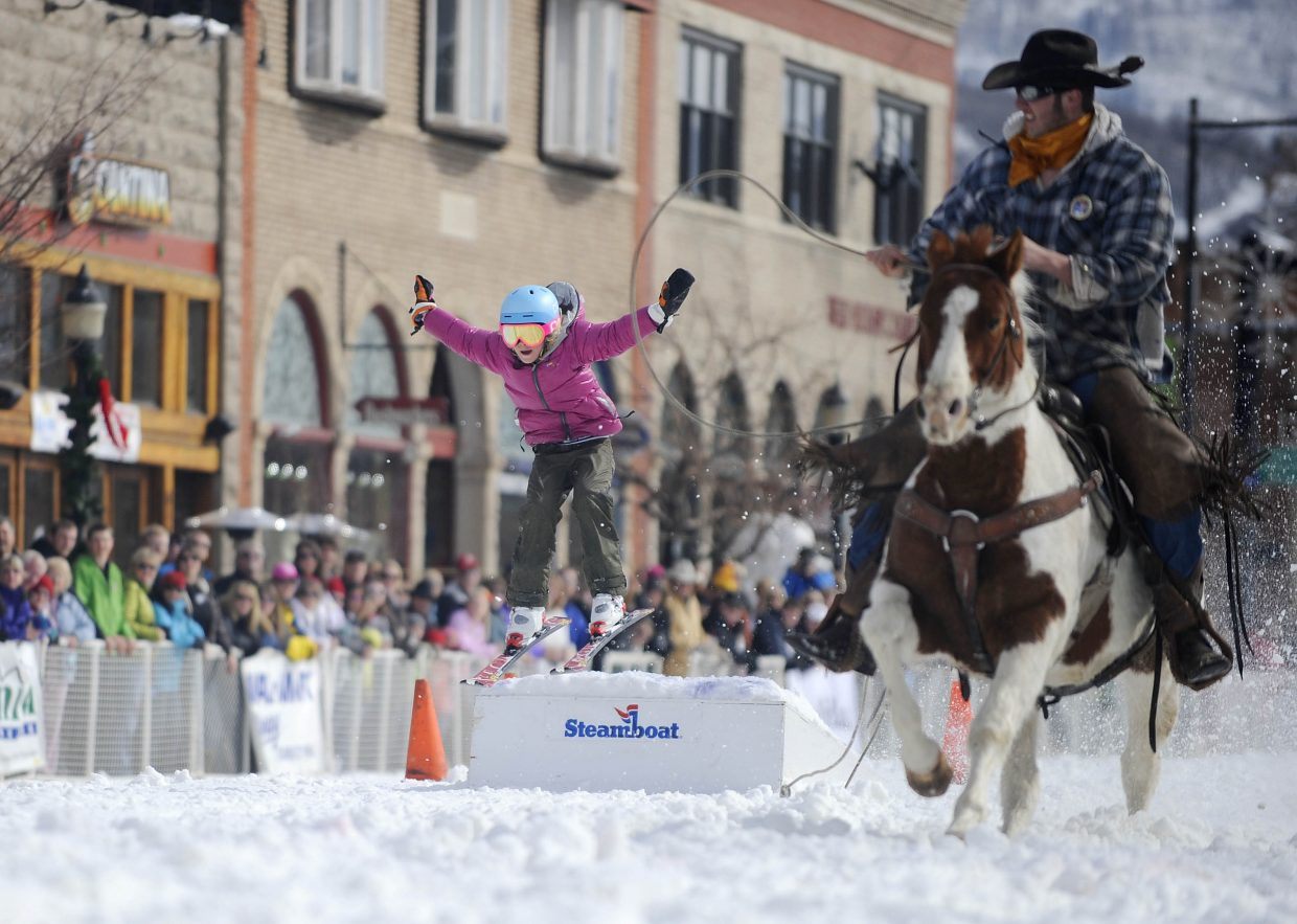 Morgan Sauerbrey competes in the skijoring event during the Winter Carnival. Skijoring is a western tradition where teams consisting of a rider, horse and a skier go through a variety of obstacles down main street. Skijoring will be a part of the 9 a.m.-noon street events on Saturday, Feb. 9.
