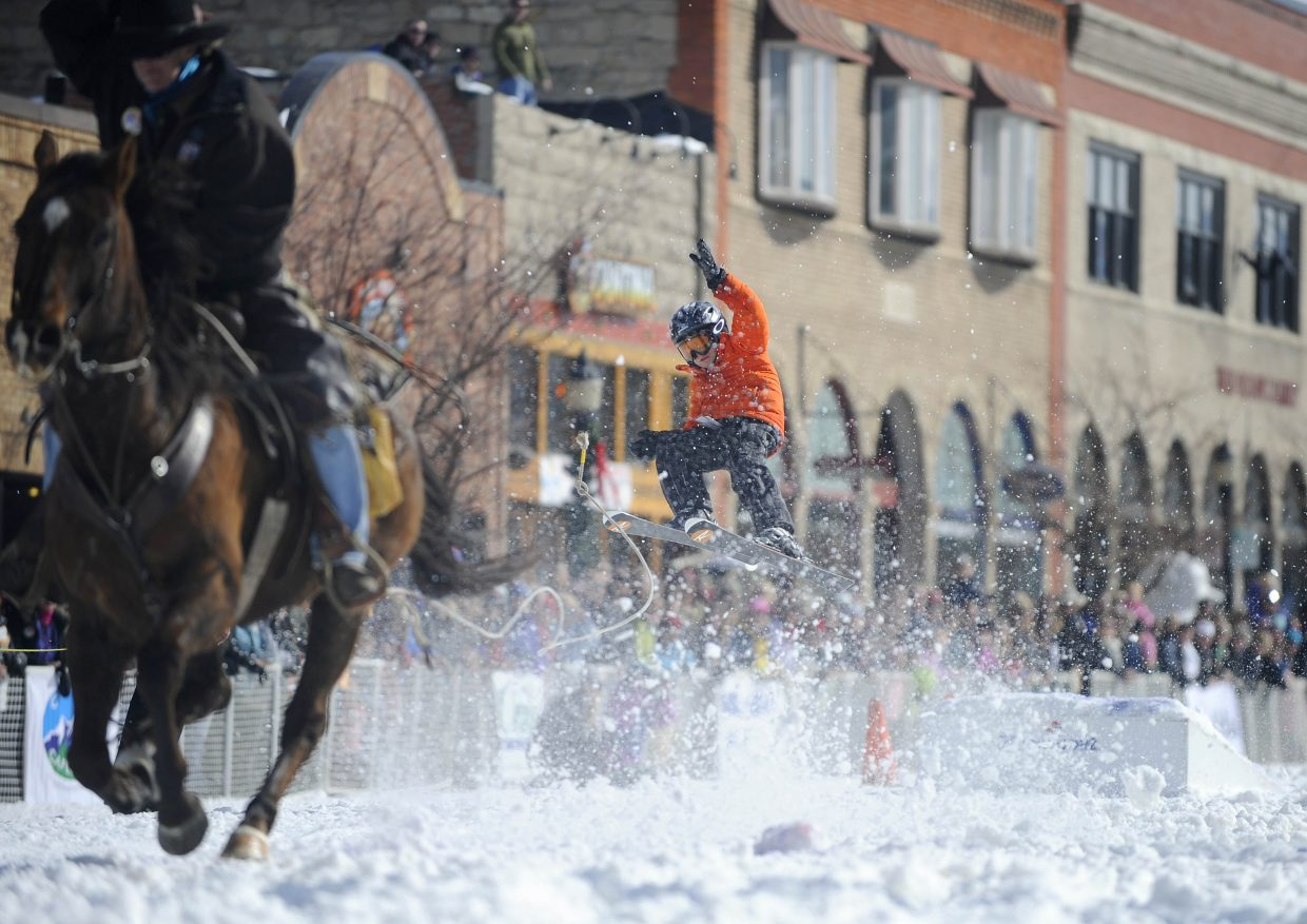 Asher Lesyshen-Kirlan competes in the skijoring event during the Winter Carnival street events Feb. 11, 2012. He won the competition.