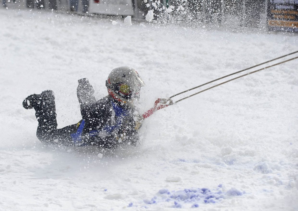 Samantha Young competes in the shovel race during the Winter Carnival street events Saturday.