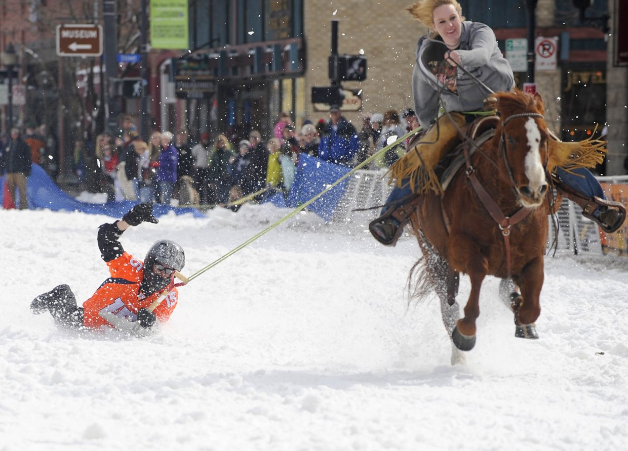 Cody Flower competes in the shovel race during the Winter Carnival street events Saturday.