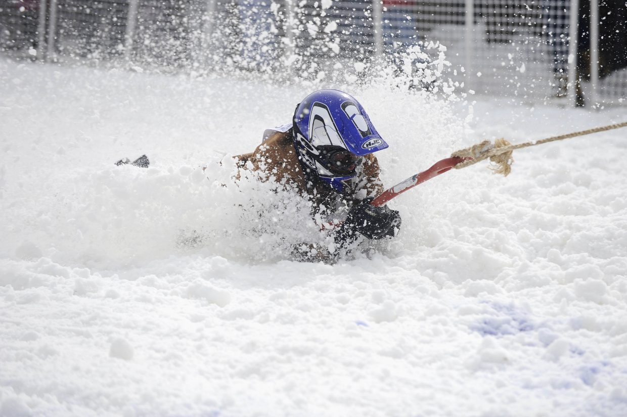 Mark Elliott competes in the shovel race during the Winter Carnival street events Saturday.