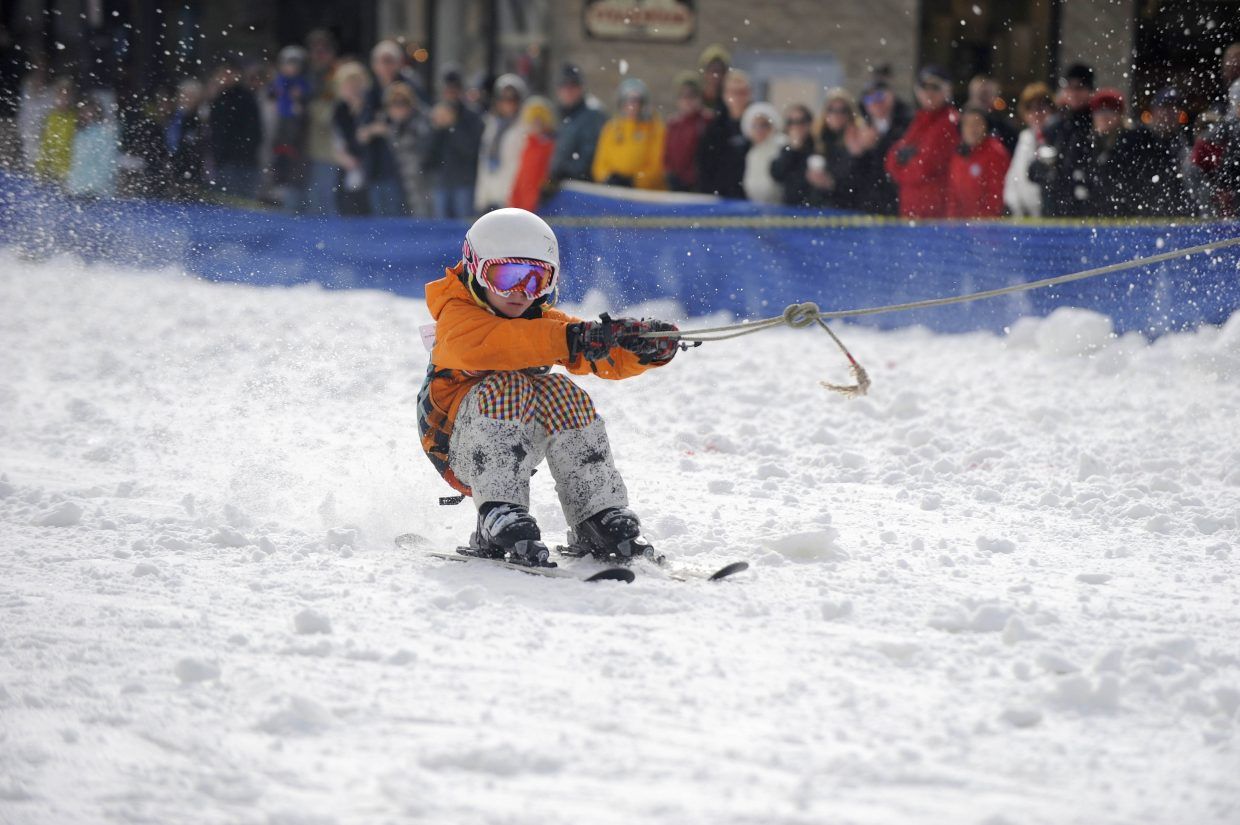 Liam Baxter competes in the skijoring event during the Winter Carnival street events Saturday.