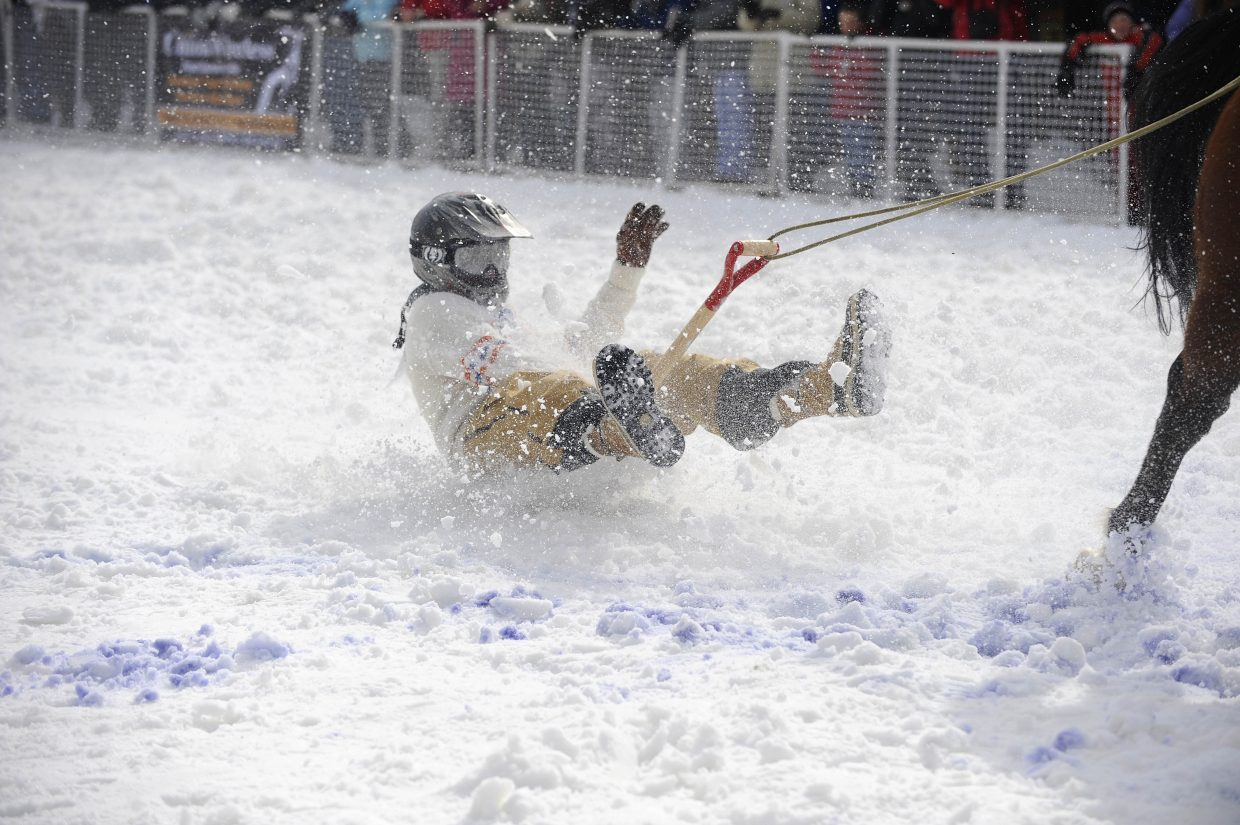 Hunter Chamness competes in the shovel race during the Winter Carnival street events Saturday.