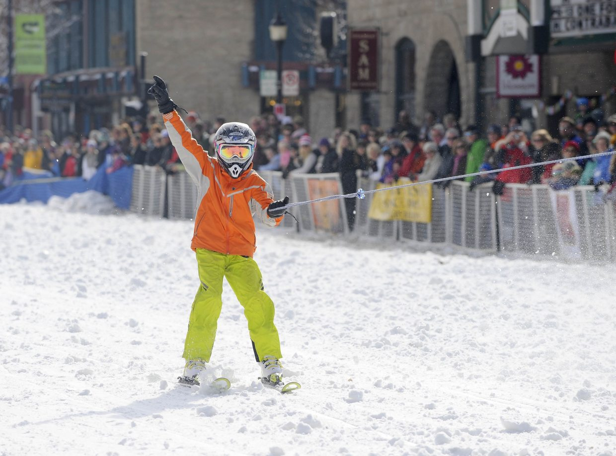 Max Pinto competes in the skijoring event during the Winter Carnival street events Saturday.