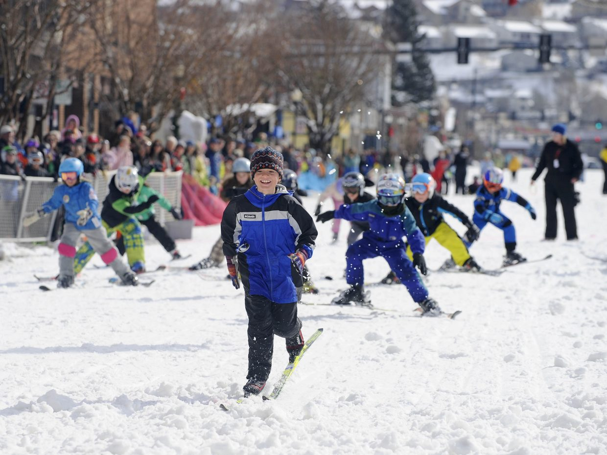 Johnathan Rawlings, 8, leads the pack during the 50-yard dash during the Winter Carnival street events Saturday.