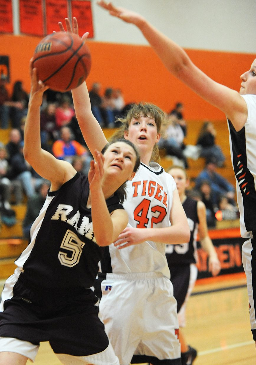 Soroco's Madison George tries to squeeze a shot up through the Hayden defense Friday as the Rams fell to the Tigers, 70-54.