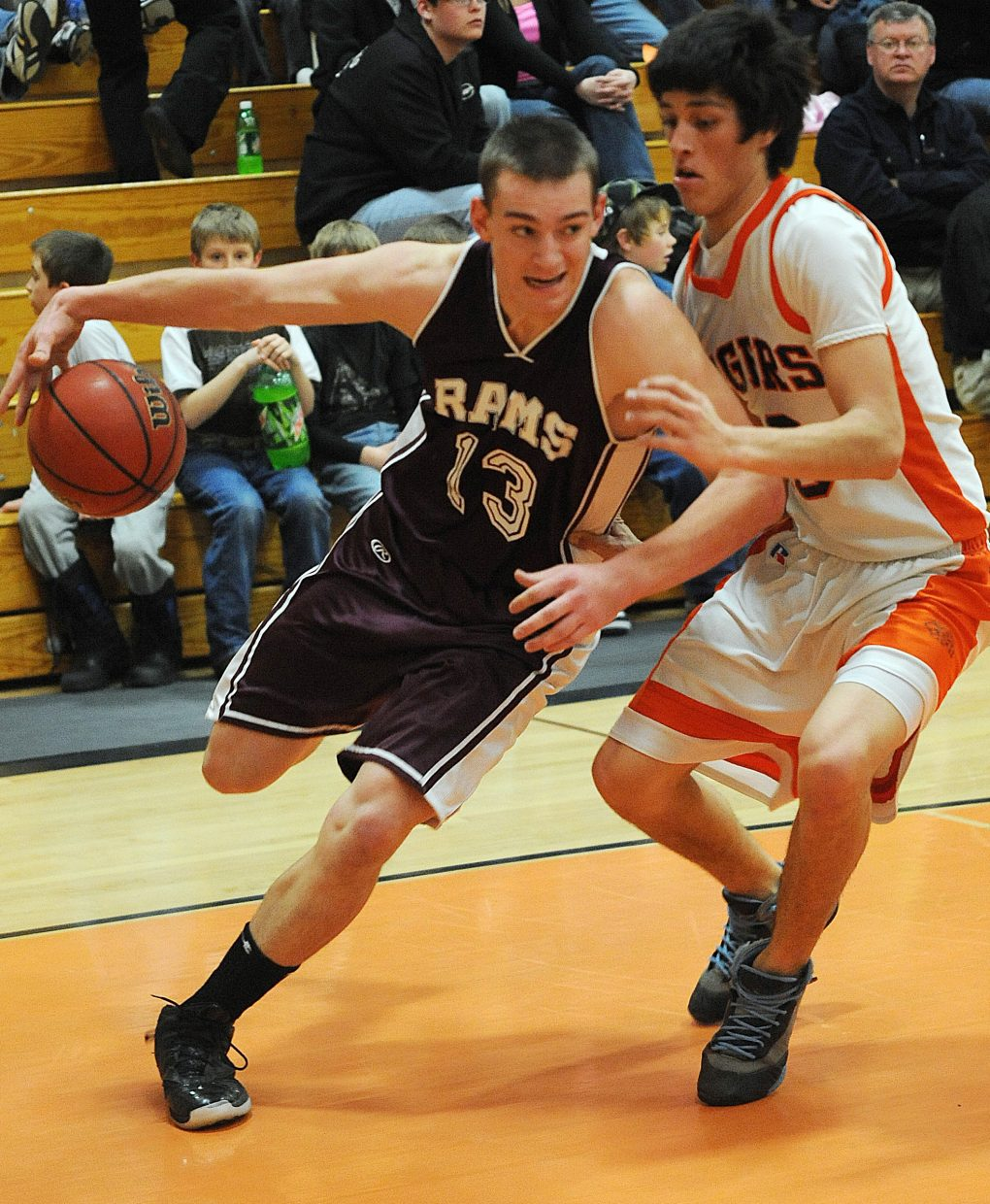 Soroco's Cody Miles tries to drive around Hayden's Rene Valdez on Friday. The Tigers managed to slow Miles and the rest of Soroco's guards with a tough defense and went on to win the game.