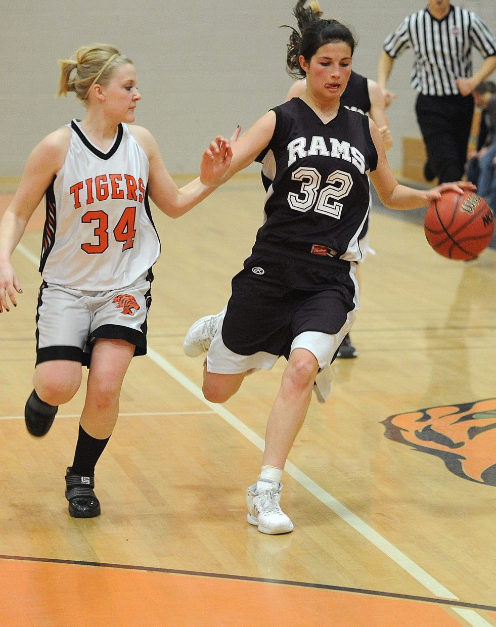 Soroco's Ceanna Rossi drives down the court against Hayden's Amber Sather. The Tigers beat the Rams, 70-54.