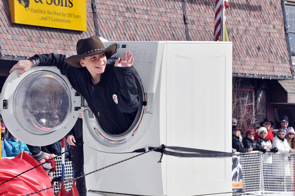 Murphy Bohlmann waves from the inside of a washing machine Sunday during the Winter Carnival's Diamond Hitch Parade. Bohlmann was a member of a parade group that promoted Steamboat Springs' Sears store.