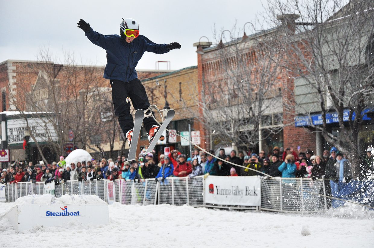 Davis Petersen gets some air off of a ski jump Sunday at the Winter Carnival in downtown Steamboat Springs.