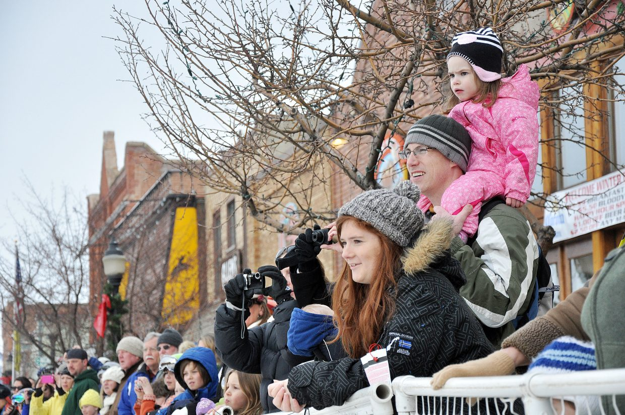 Layla McGann watches the Winter Carnival street events Sunday on Ryan McGann's shoulders. The McGann family was visiting Steamboat from Pennsylvania.