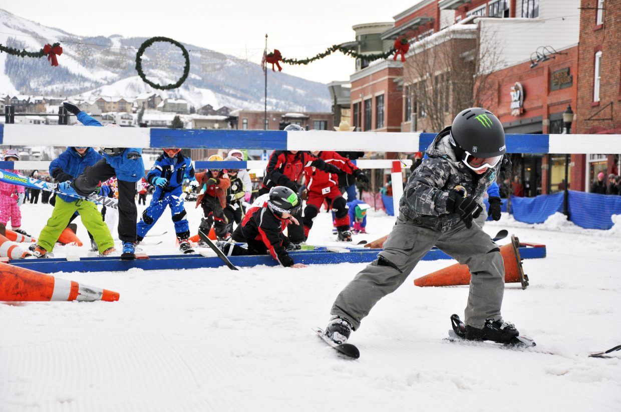 Logan Spiegel leads skiers through an obstacle course Sunday during the Winter Carnival