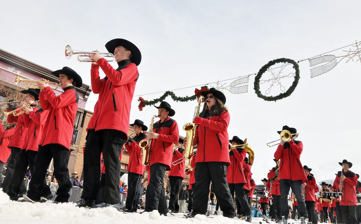 The Steamboat Springs High School marching band performs Sunday in the Winter Carnival's Diamond Hitch Parade.