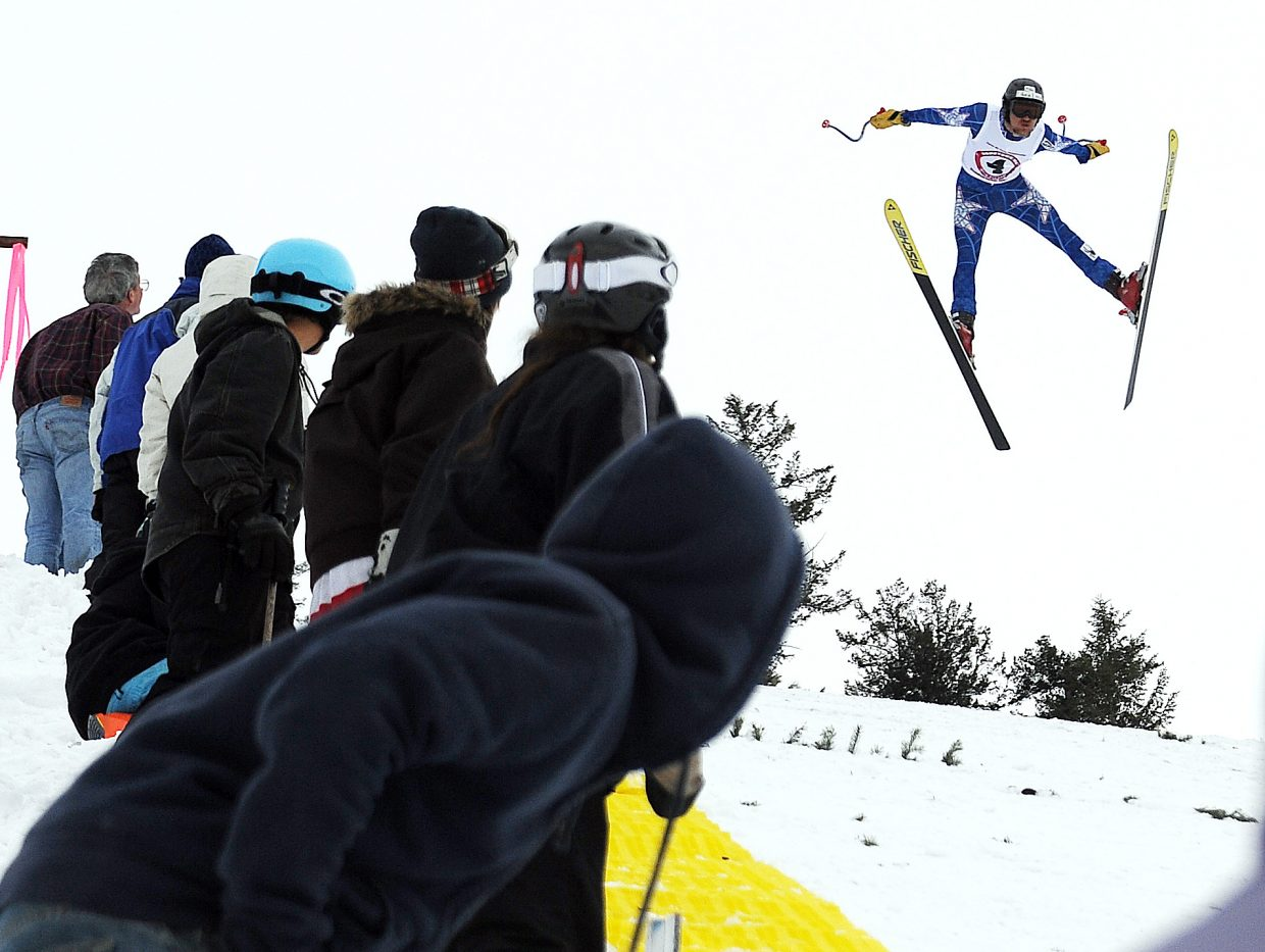 Erik Gilbert soars down the jump at Howelsen Hill in front of spotters trying to mark his landing distance Sunday during the Alpine Ski Flying Championship in Steamboat Springs.