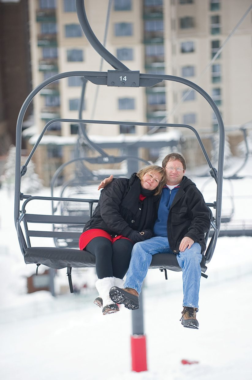 Jill and Barry Limberg take a ride up the slopes of Steamboat Ski Area on the Preview lift last week. The two said they were introduced while working as lift operators on Preview in 1986.