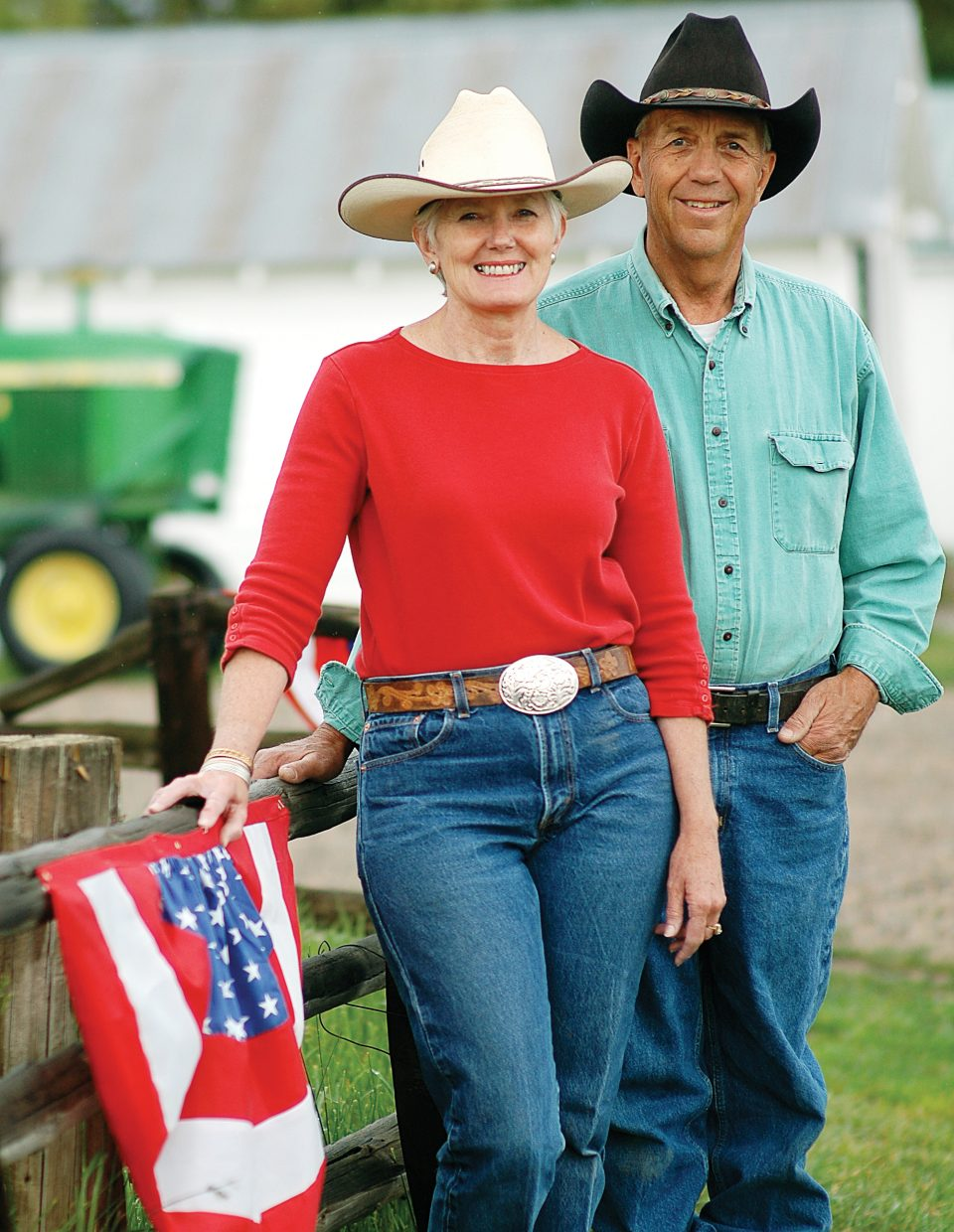 """Marsha and John Daughenbaugh have long since settled into daily routines on the ranch they've worked for 38 years. Marsha Daughenbaugh said John """"does the organizing for the outdoors stuff"""" and she does """"all the bookwork and helps outside, as well."""" They got some time off the ranch here, as grand marshals of the 2009 Fourth of July Parade in downtown Steamboat Springs."""