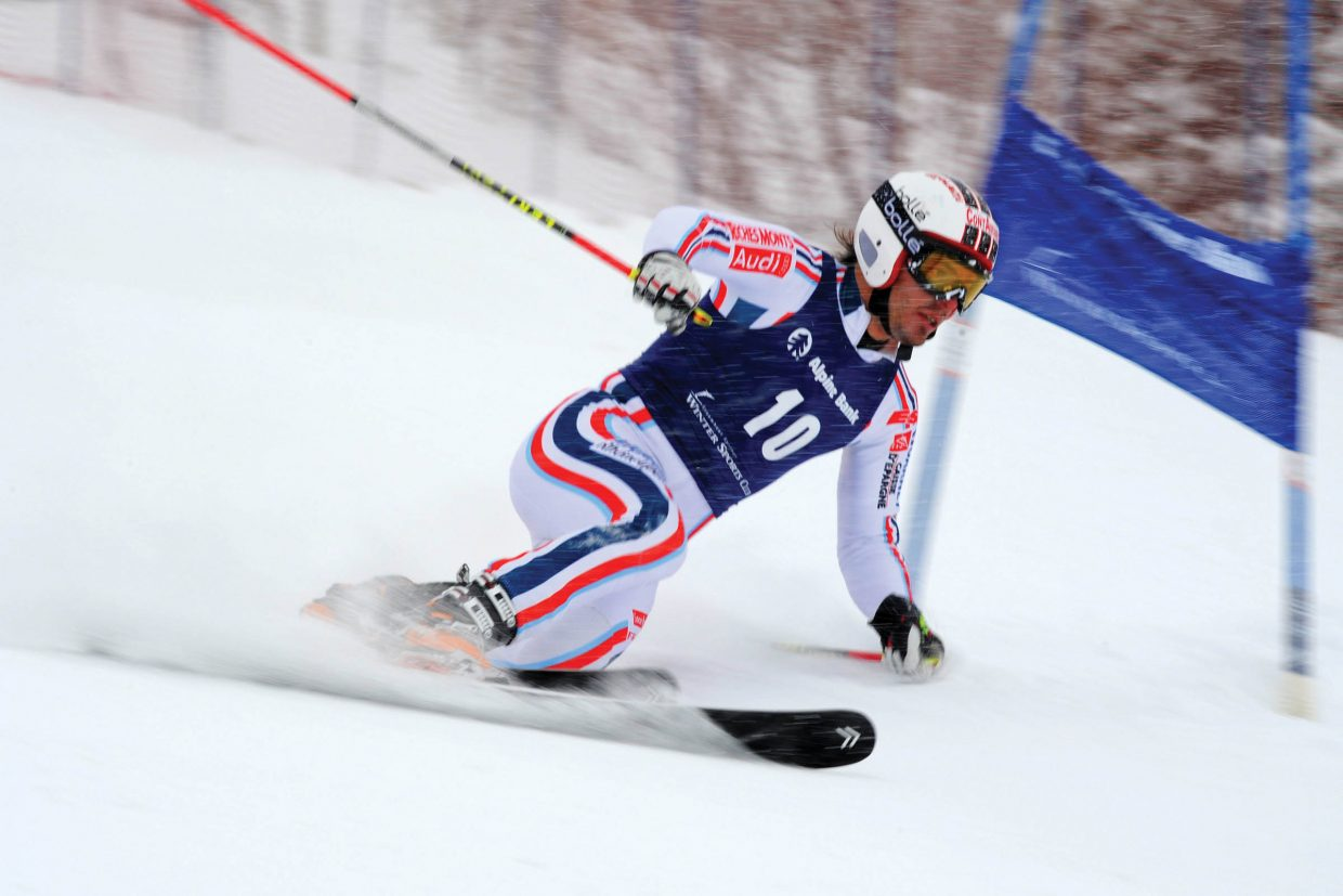 France's Antoine Bouvier speeds around a gate during a Telemark World Cup classic race, which was held Monday on the slopes of the Steamboat Ski Area.