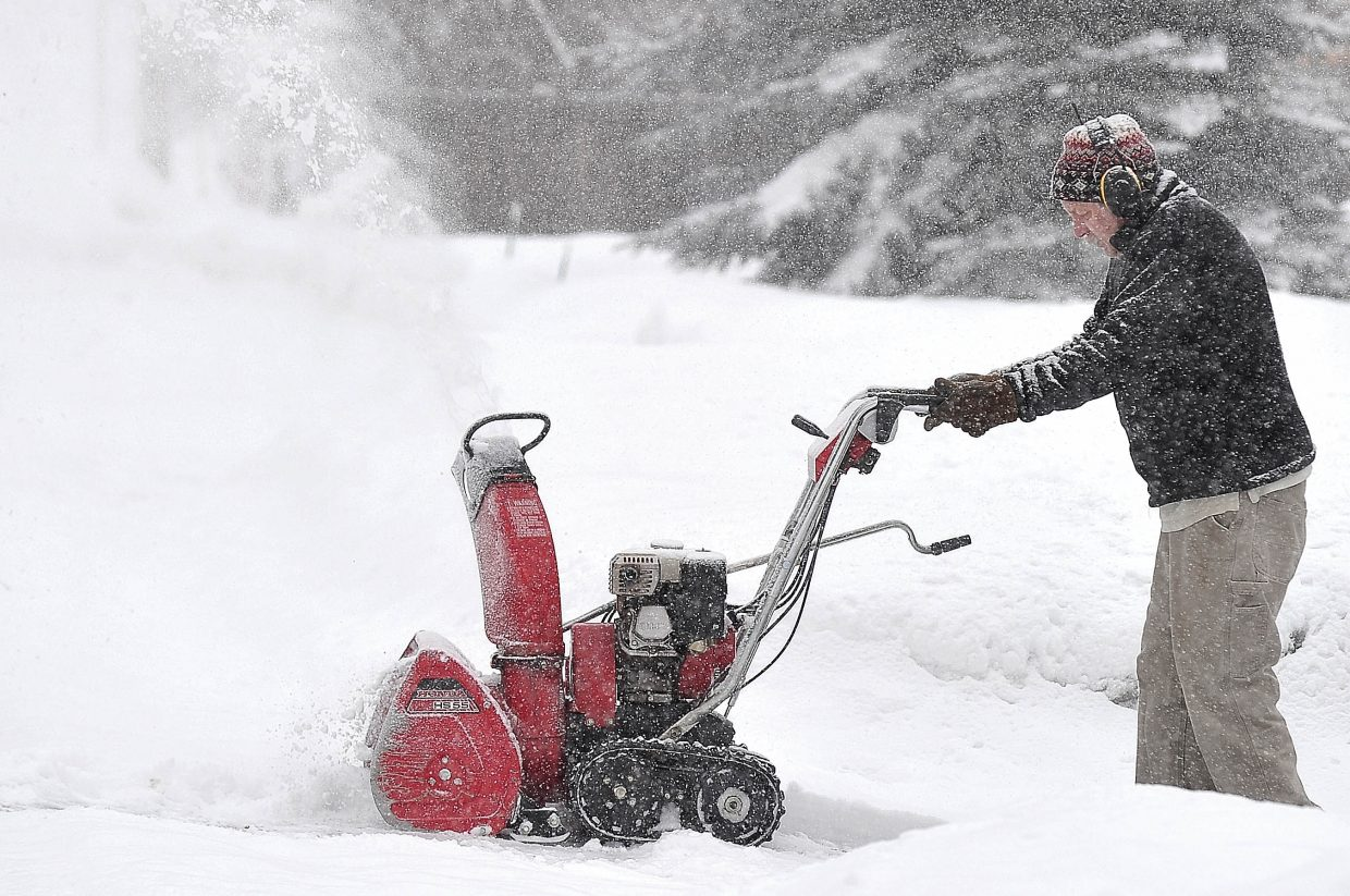 Steamboat Springs resident Bob Cordell blows snow from his driveway on Steamboat Boulevard late Tuesday morning. A winter storm passed through the area Tuesday, leaving several inches on snow in the Steamboat Springs area.