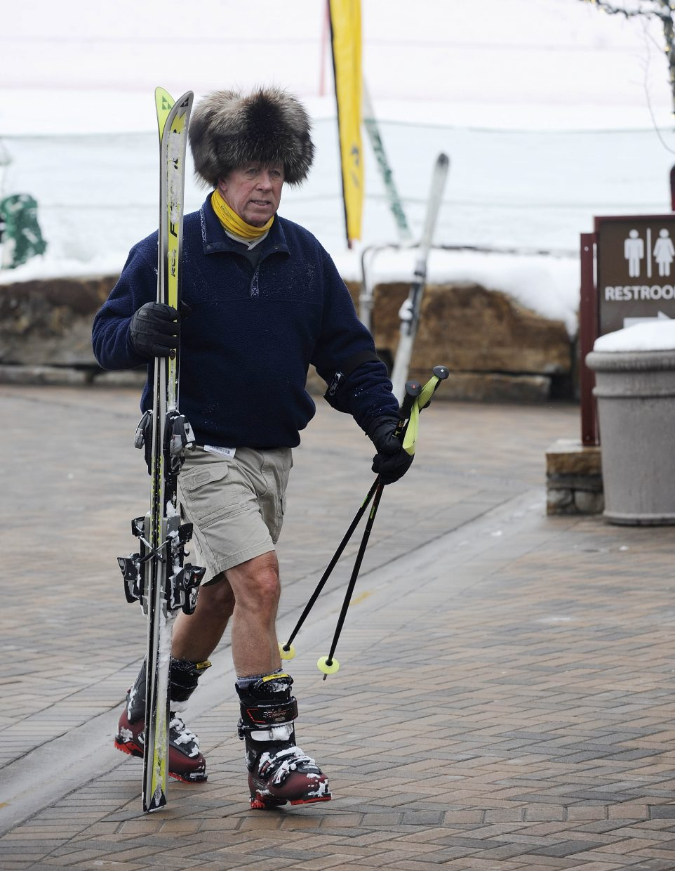 Connecticut resident Hal Taylor walks toward the gondola after making a run Tuesday at Steamboat Ski Area.