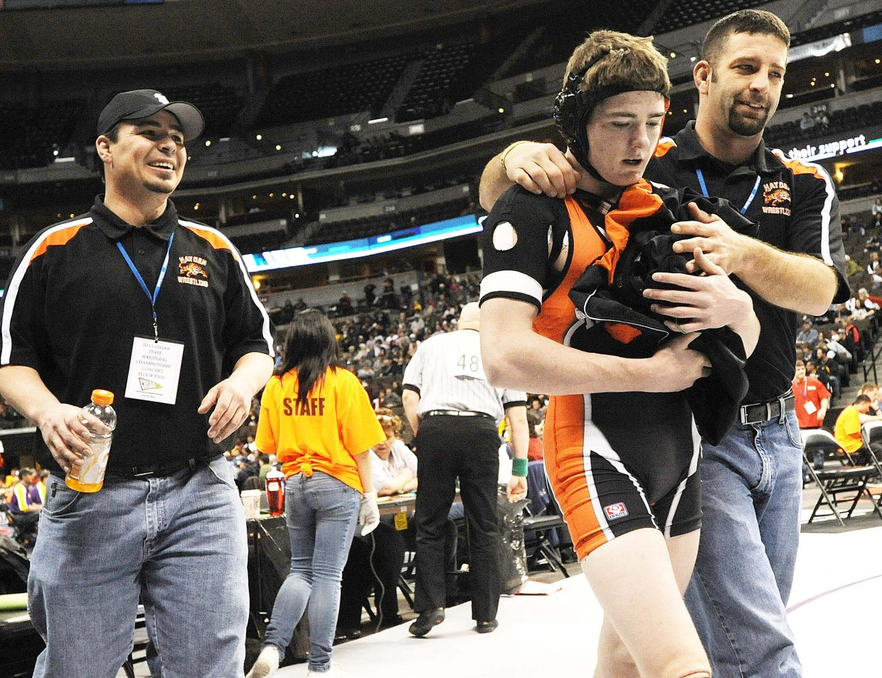 Hayden coach Ty Camilletti leads junior Chad Terry off the mat Friday after Terry won in the quaterfinal round of the state wrestling tournament in Denver.