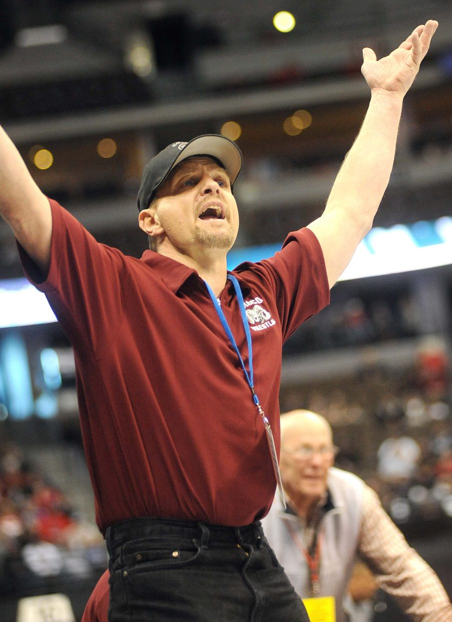 Soroco assistant coach Travis Bruggink urges on a Rams' wrestler Thursday during the first round of the Class 2A state wrestling tournament in Denver.
