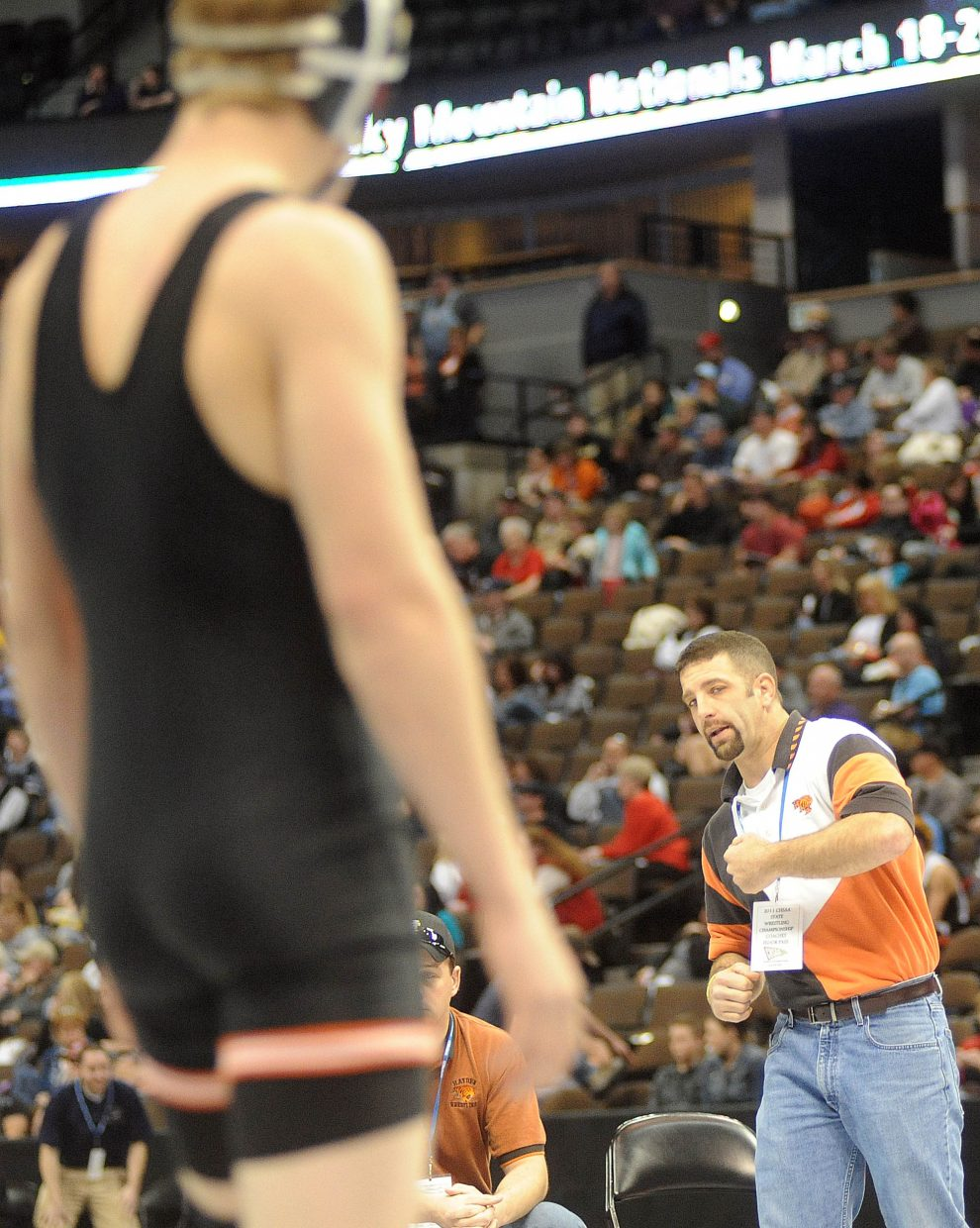 Hayden coach Ty Camilletti throws a tip to Ryan Domson on Thursday during the first round of the Class 2A state wrestling tournament in Denver.