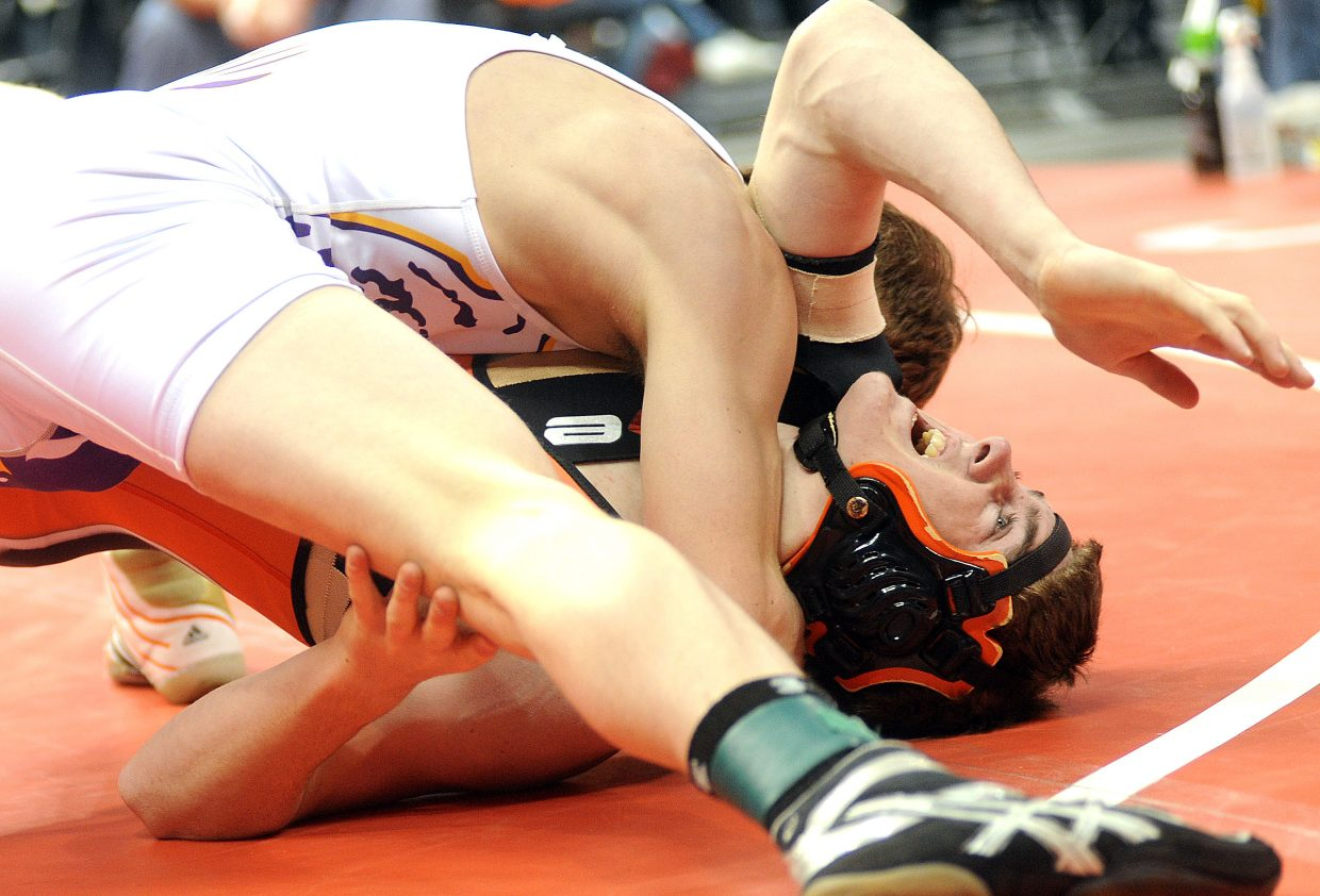 Hayden's Chad Terry shouts in pain after being taken to the mat during the first period of his state semifinal match. Terry struggled throughout the match with a dislocated shoulder and went on to lose. He will wrestle in the consolation bracket today.