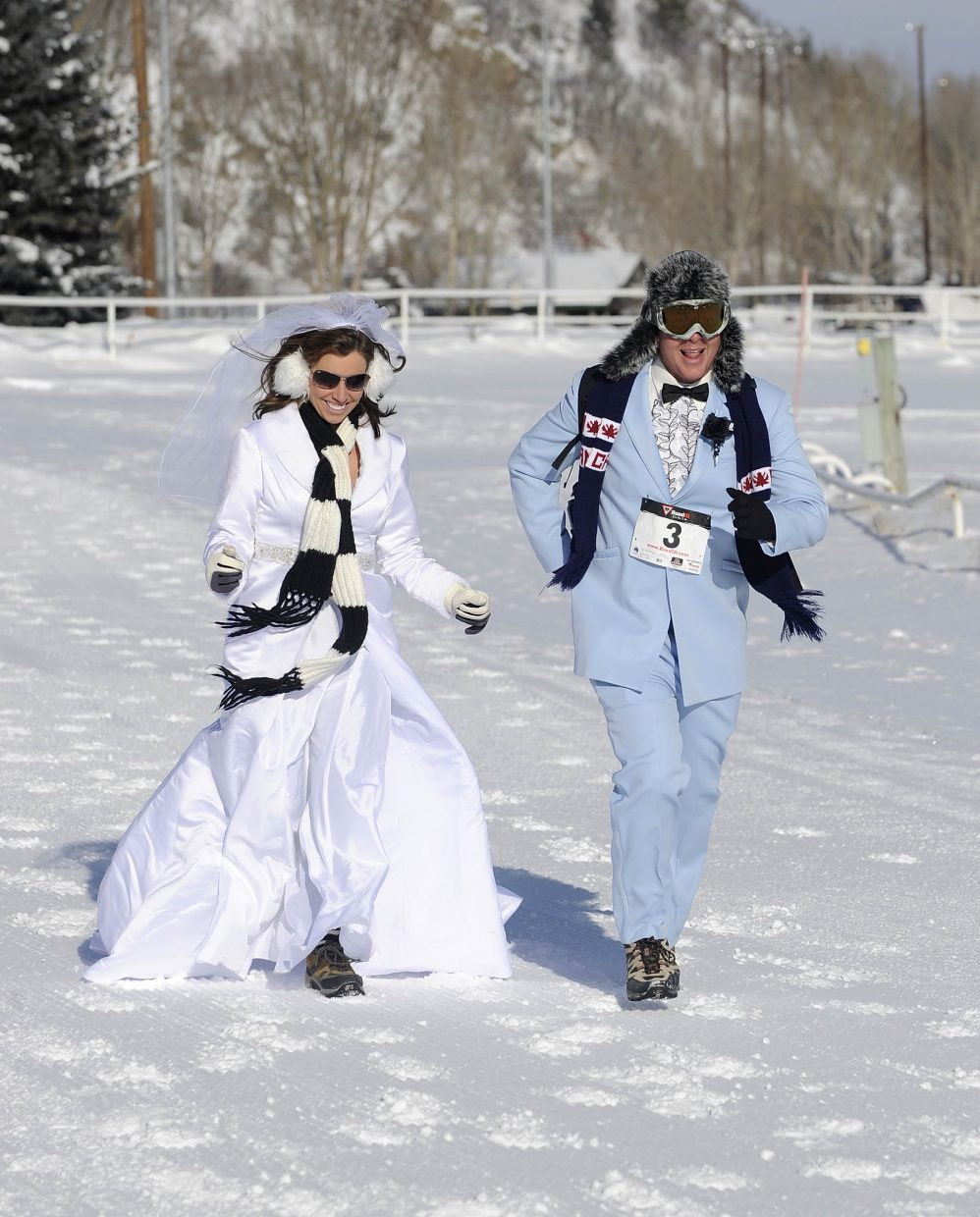 Melissa and Walter Christopherson run the Love the Run You're With 10K in their wedding attire on their first anniversary Saturday. The Steamboat Springs Winter Running Series event took place on a snowy Emerald Mountain course.