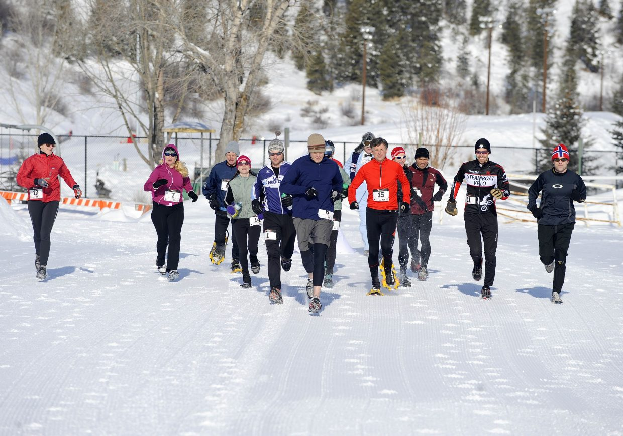 Runners leave the starting line during the Steamboat Spring Winter Running Series Love the Run You're With race Saturday at Howelsen Hill.