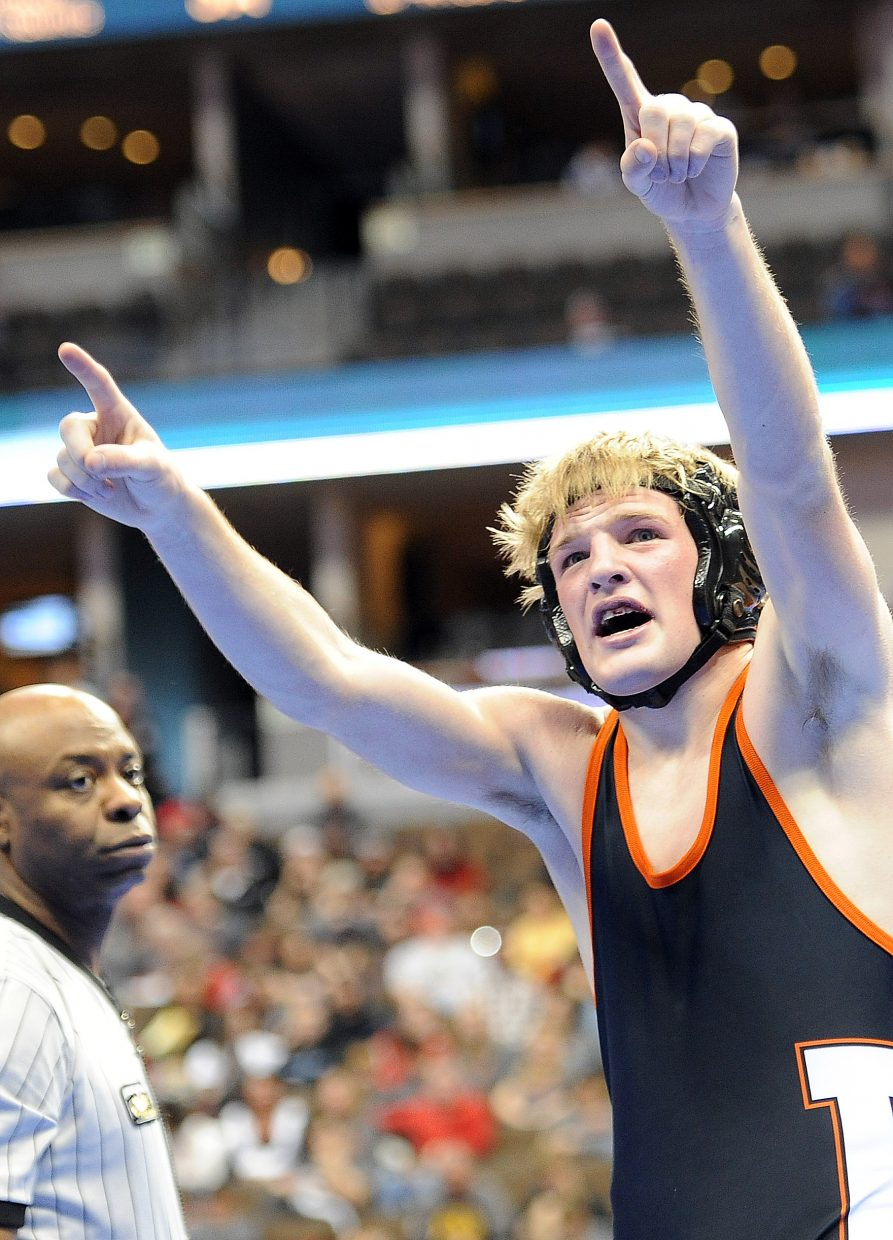 Hayden senior Nick Williams celebrates Saturday at the state wrestling tournament in Denver. He finished fourth at 138 pounds.