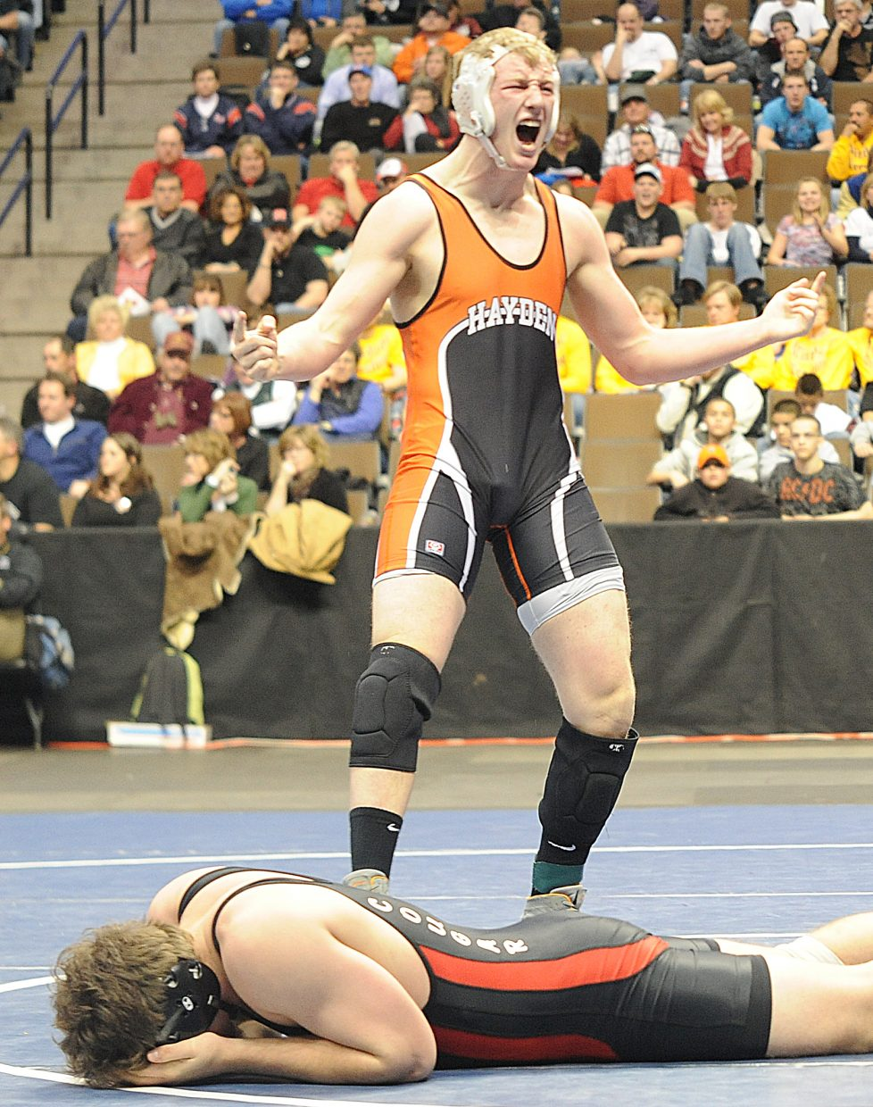 Hayden junior Treyben Letlow celebrates his Class 2A 215-pound state championship in Denver after beating Mike Slatterly, of Burlington, 5-1. Letlow finished the season a perfect 36-0.