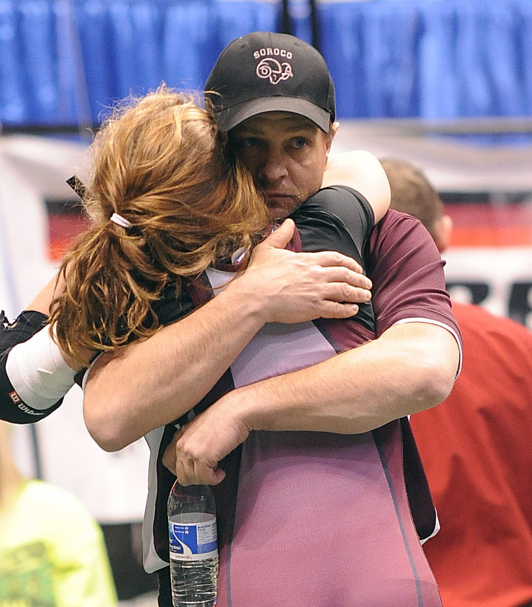 Lauryn Bruggink hugs her dad and coach, Travis Bruggink, after a loss Saturday in the consolation quarterfinals of the 103-pound bracket at the state wrestling tournament in Denver.
