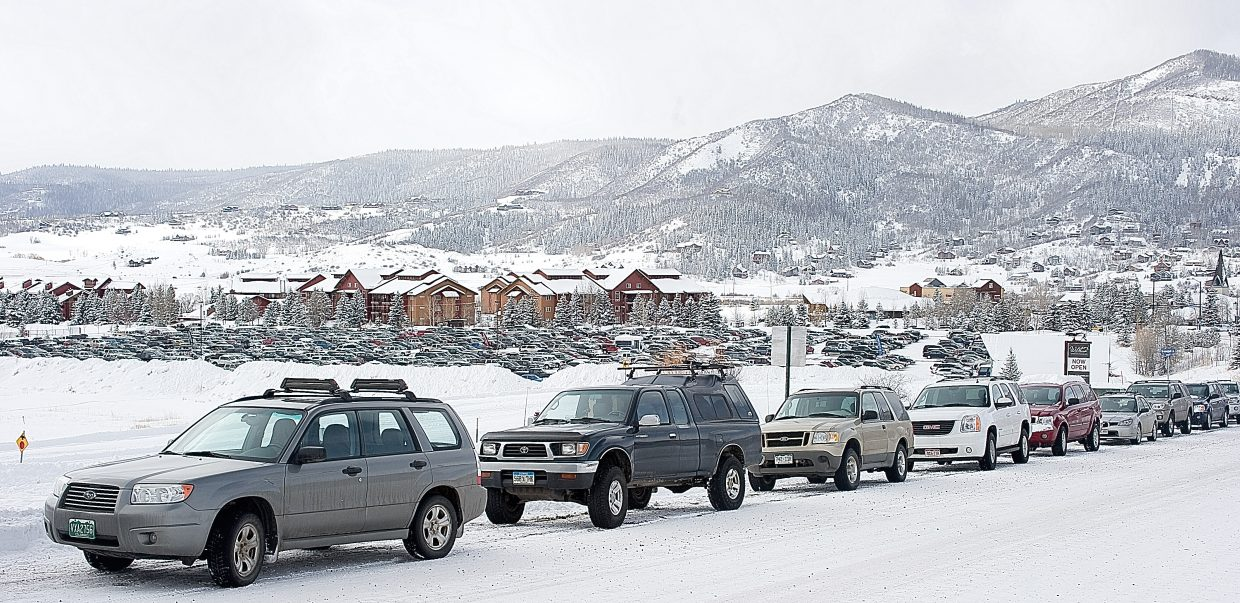Cars line Mount Werner Road on Monday afternoon and pack the Meadows Parking Lot in the background as skiers flocked to the slopes of Steamboat Ski Area to take advantage of the area's most recent snowfall. Steamboat reported getting 27 inches of snow in a 24-hour period.