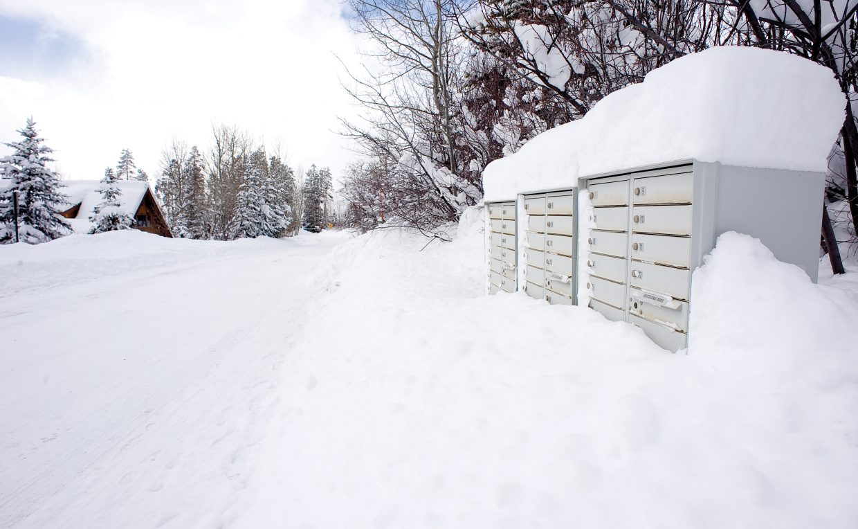 Mailboxes along Burgess Creek Road in Steamboat Springs were buried in snow Monday after the most recent storm dropped a reported 27-inches of snow in the area during a 24-hour period starting Sunday afternoon.