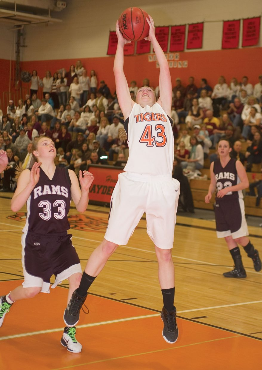 Tiger Savannah Williams pulls down a rebound in the second half of Tuesday's district playoff game against Soroco in Hayden.