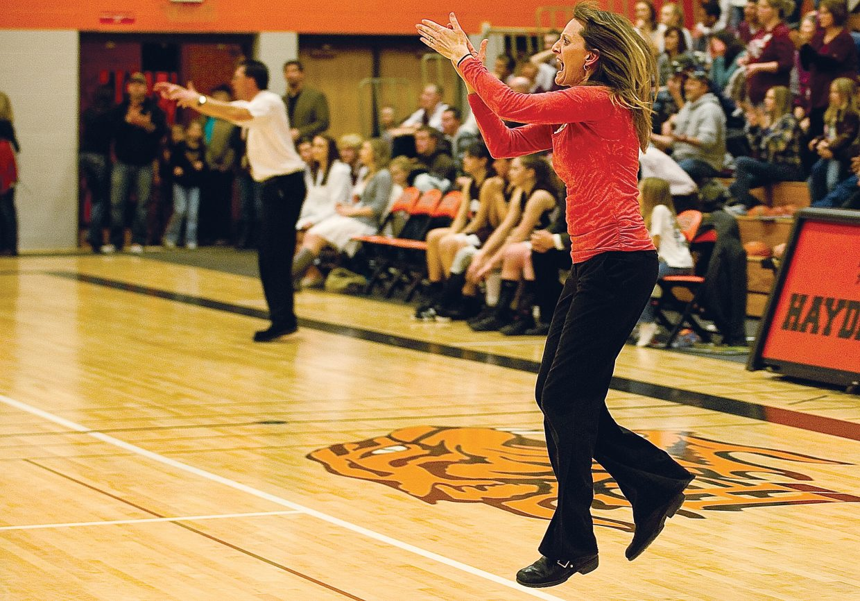 Michelle Wilkie celebrates the Tigers' 52-51 win against the Soroco Rams in the opening game of the district tournament Tuesday night in Hayden.