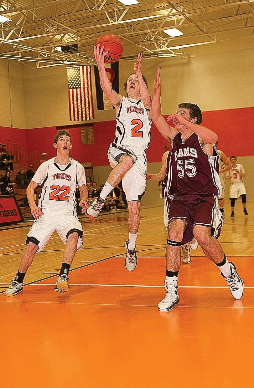 Hayden senior Hunter Johnston goes in for a layup in the first half of Tuesday's district playoff game against Soroco.