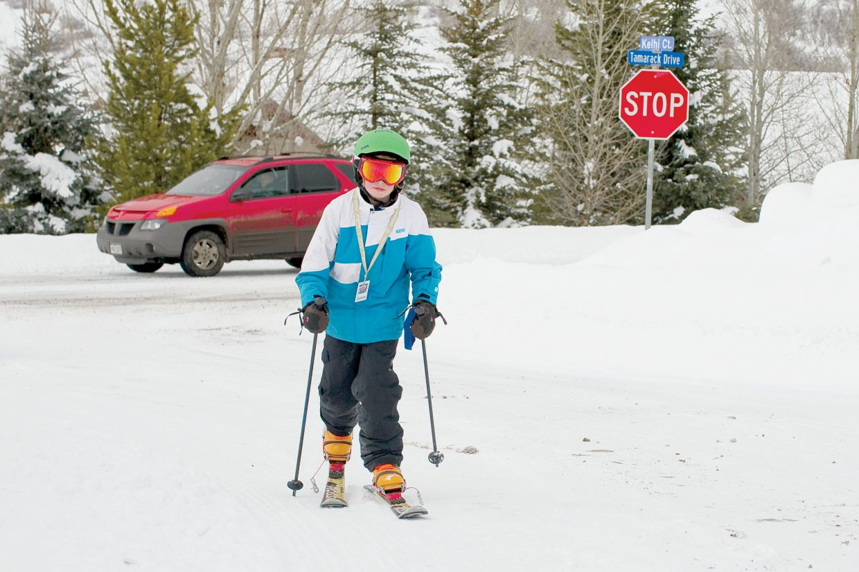 Sean Janka makes his way home from the bus stop on Tamarack Drive after another day of powder Wednesday at Steamboat Ski Area.