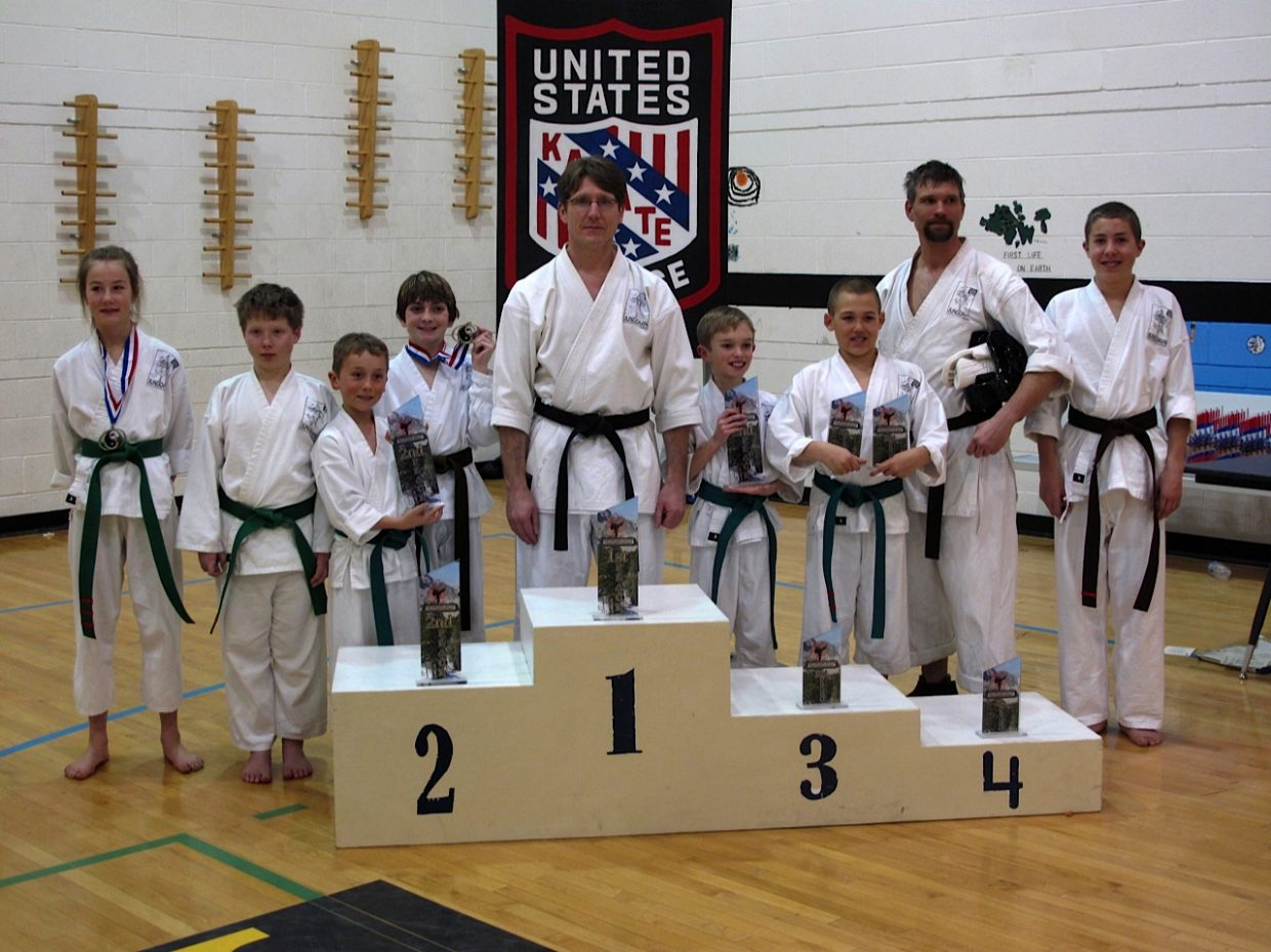 Students from The Rocky Mountain Karate Academy attended the 2012 Colorado State Championships on Saturday in Eagle. Pictured, from left, are Isabell Feldman, Colton Oleski, Henry Cardillo, Ross Van Hara, Sensei Michael David Bauk, Jackson Creagan, Finn Russell, Ben Russell and Chas Feldman. Bauk took 10 students to the championships, with nearly all competitors bringing home trophies in one of two disciplines. Competitors either competed in kata, prearranged movements and forms, or in sparring. Steamboat Springs students competed against others of similar rank and age, but those competitors had years of experience competing in multiple tournaments. Most of the Steamboat students never had been to a competition of this caliber.