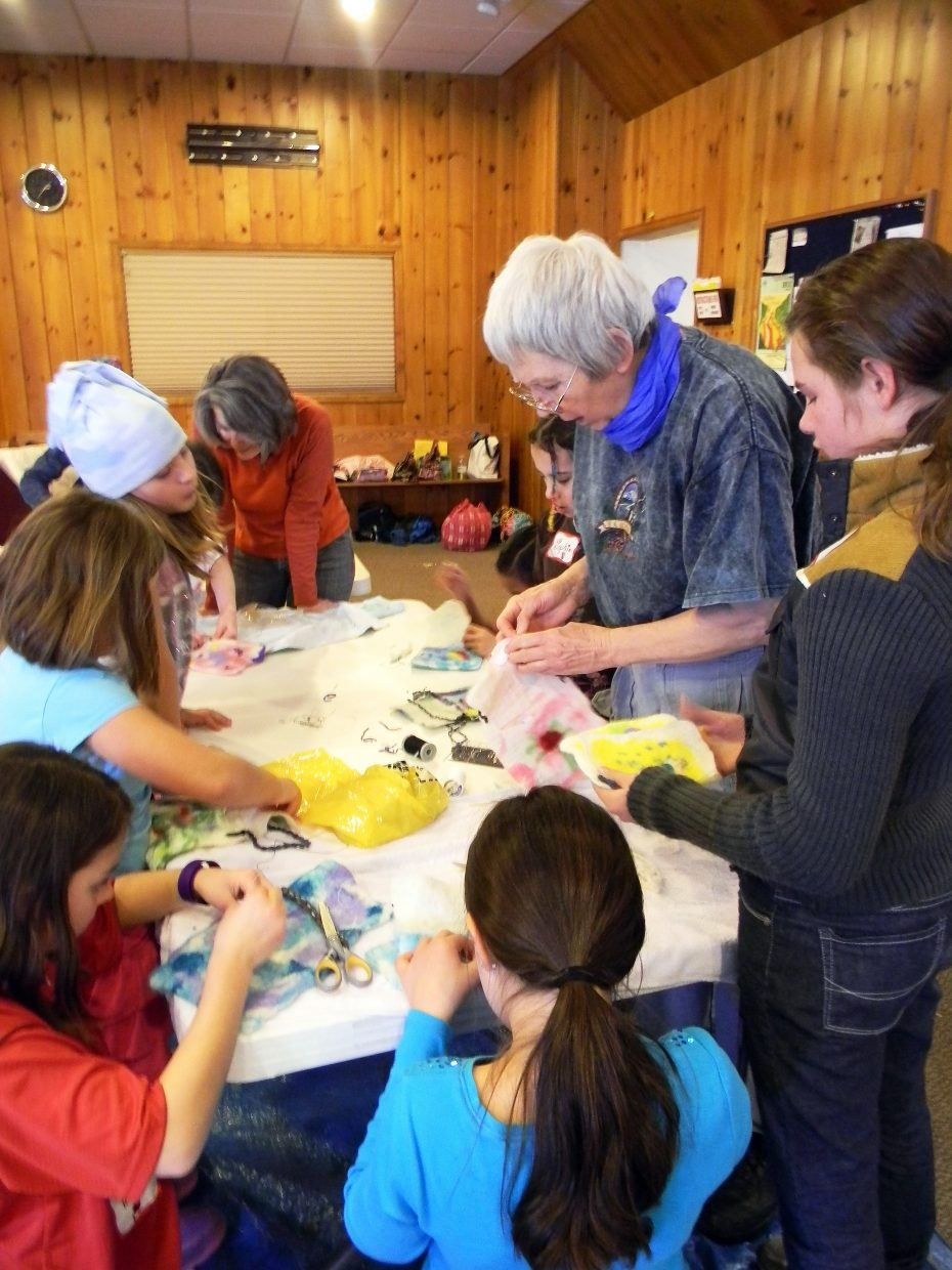 Routt County 4-H volunteer Rosemary Farrell teaches the art of felting wool to a group of local students Wednesday at a 4-H Fiber Arts Camp at United Methodist Church of Steamboat Springs. Routt County 4-H was a recipient of one of two $10,000 grants from Steamboat Ski & Resort Corp.