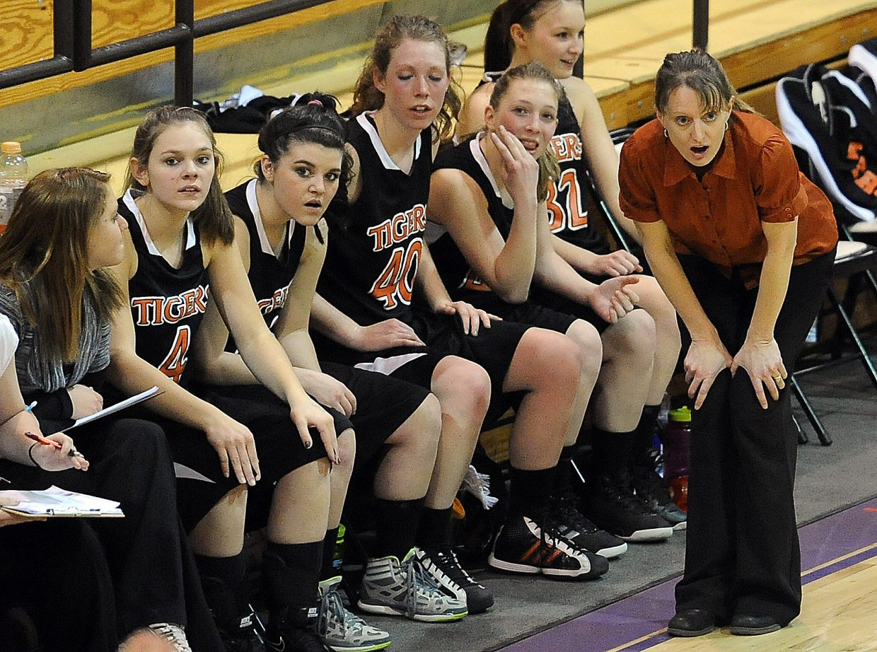 Hayden coach Michelle Wilkie and the Tigers' bench react to a call Friday during the district basketball tournament in Kremmling.