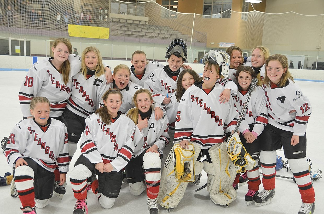 Steamboat Springs U-12 AA girls hockey team celebrates its third-place finish in the MSGHL tournament at the Edge Ice Arena in Littleton on Sunday.