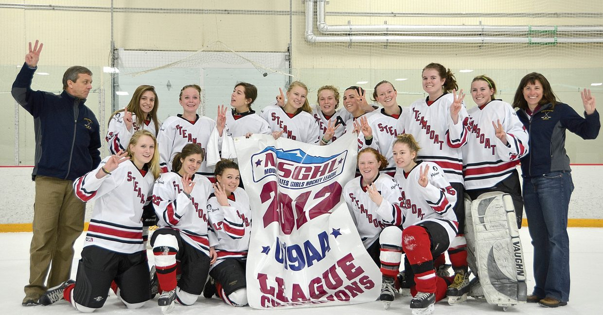 Steamboat Springs U-19 AA girls hockey team celebrates its third straight title at the Edge Ice Arena in Littleton on Sunday.