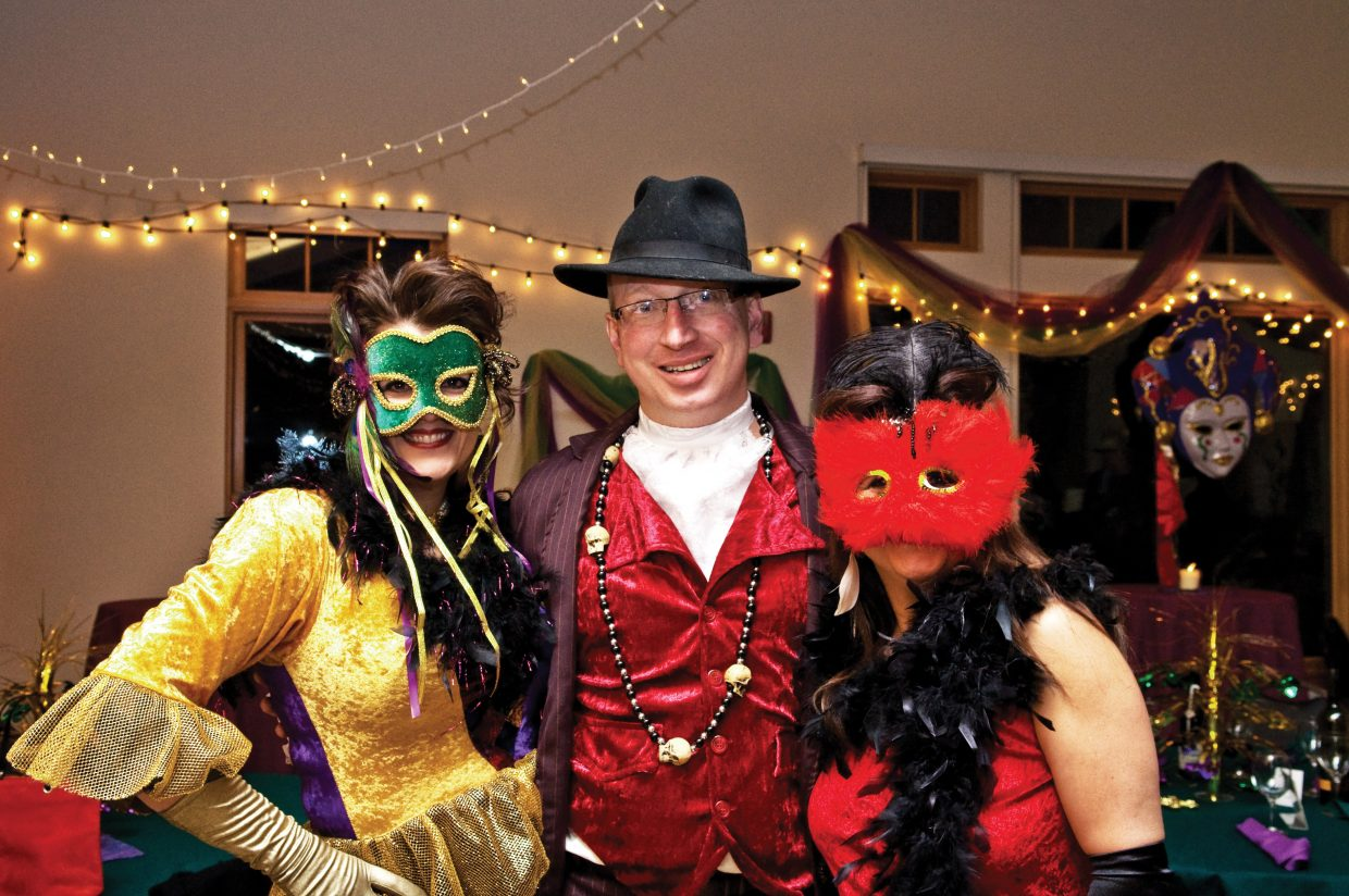 Sharon Timmerman, left, and her husband, Doug, center, celebrate last year's Mardi Gras Masquerade Ball fundraiser for the Yampa Valley Autism Program with Babette Dickson, right. This year's fundraiser is from 6 to 11 p.m. Saturday at the Steamboat Springs Community Center.
