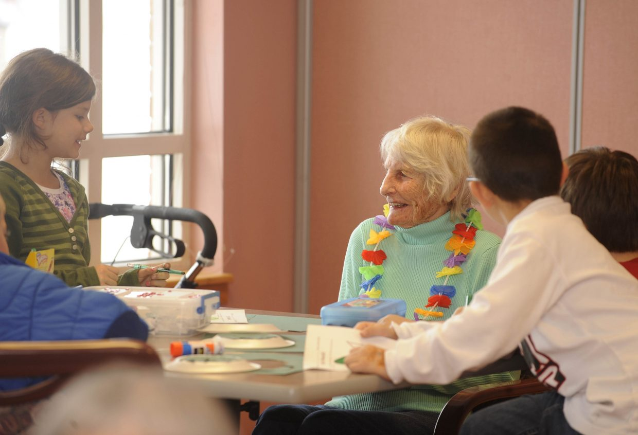 Strawberry Park Elementary School students visit with Doak Walker Care Center resident Mollie Mahony on Wednesday.