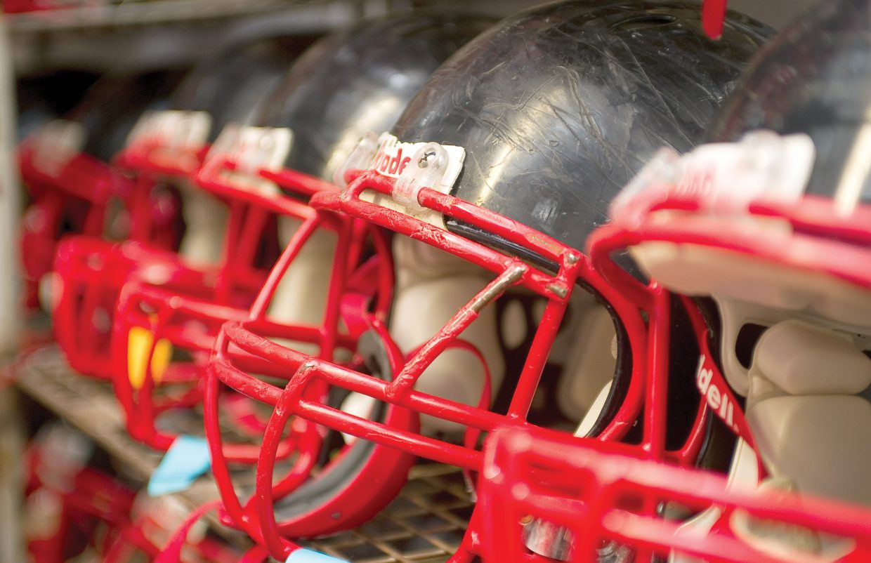 The Steamboat Springs High School football team and coach Lonn Clementson are raising money to try to purchase new helmets.