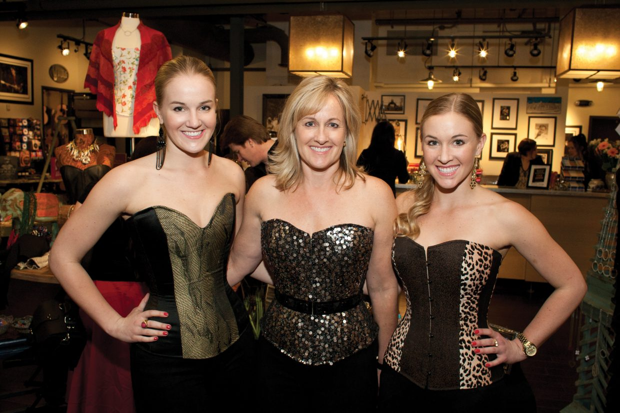 Ariel Tredway, left, her sister, Danielle, right and their mother, Dana, pose at the sisters' launch party for their custom corset company, ani&ari, in January. The Nashville-based fashion line has received national attention.