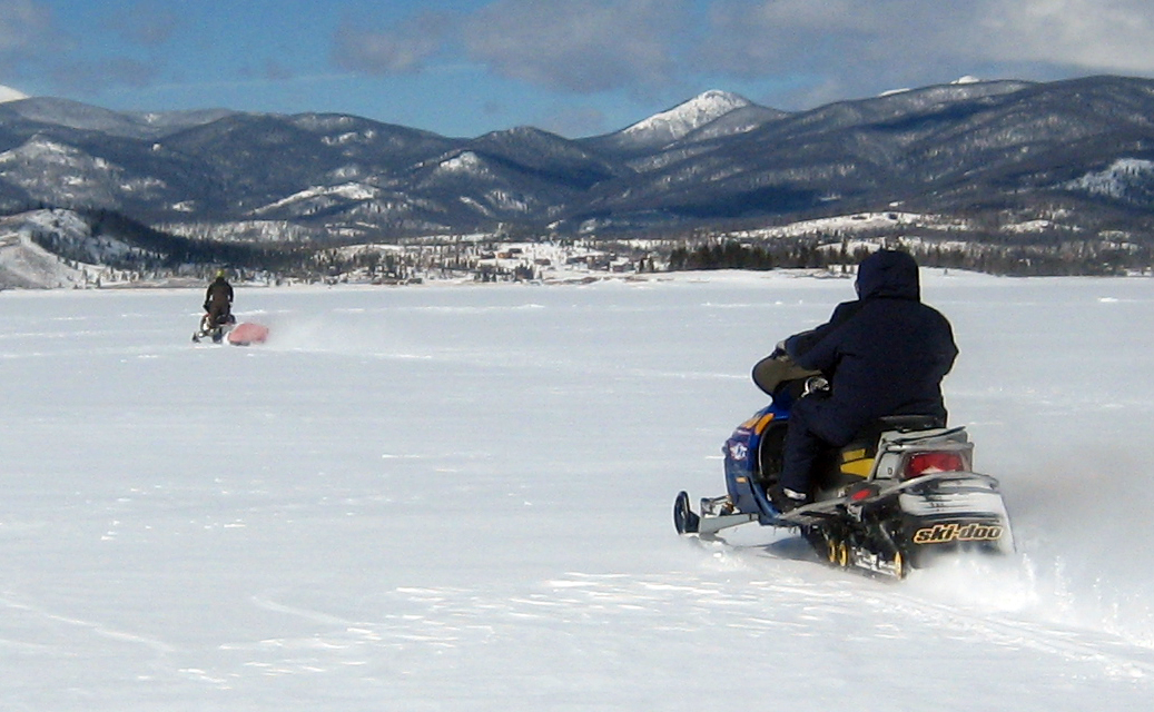 John Hanick, left, and Dean Leahy rip across Lake Granby on snowmobiles last week.