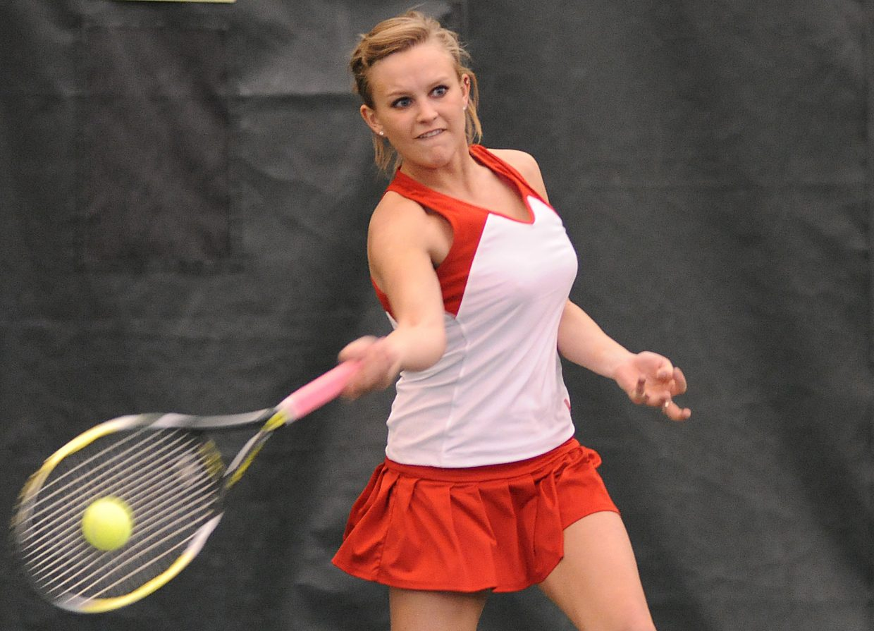 Steamboat's Sara Bearss swings for a return Friday as the tennis team opened its season at home.